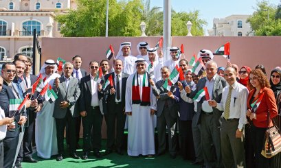 The UAE flag 'Lift it skyward, to keep it towering' at Al Ain University